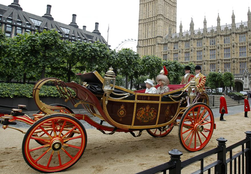 Britain's Queen Elizabeth II  travels by carriage to Buckingham Palace with Camilla, the Duchess of Cornwall  after a lunch at Westminster Hall.  (AP Photo/Peter Byrne, Pool)