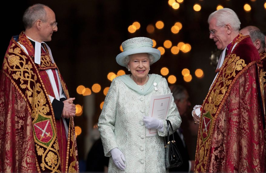 Britain's Queen Elizabeth II departs St Paul's Cathedral, London  with the Dean of St Paul's David Ison, left, following a service of thanksgiving on the last day of the Queen's Diamond Jubilee celebrations.(AP Photo/Alastair Grant)