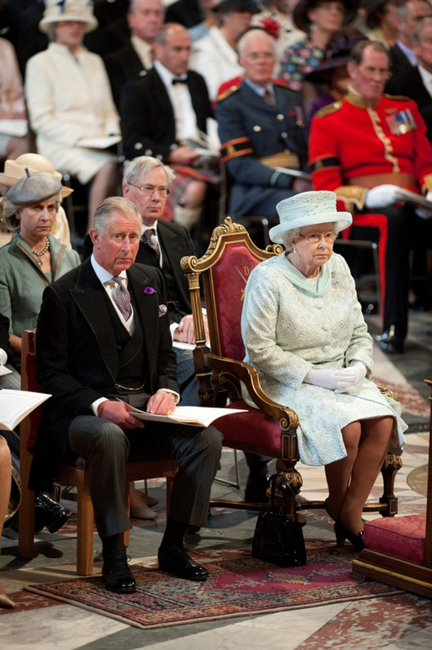 Britain's Queen Elizabeth and Prince Charles attend the service of thanksgiving to celebrate the Queen's Diamond Jubilee in St Paul's Cathedral London. (AP Photo/Murray Sanders, Pool)