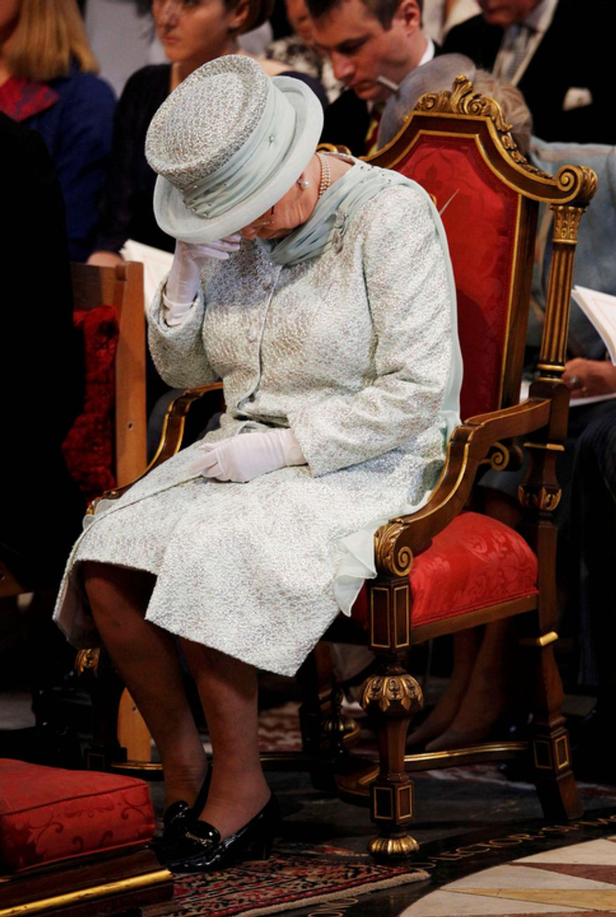 Britain's Queen Elizabeth II wipes her eye during a thanksgiving service to celebrate her Diamond Jubilee at St Paul's Cathedral. (AP Photo/Suzanne Plunkett, Pool)