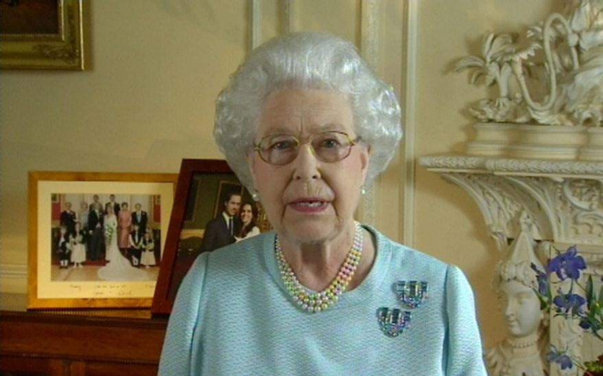 """Britain's Queen Elizabeth II addresses the country and Commonwealth on Tuesday, June 5, 2012, during her Diamond Jubilee celebration. The queen, in the two-minute message recorded the day before, said: """"The events that I have attended to mark my Diamond Jubilee have been a humbling experience. It has touched me deeply to see so many thousands of families, neighbors and friends celebrating together in such a happy atmosphere."""" (AP Photo/ITN)"""