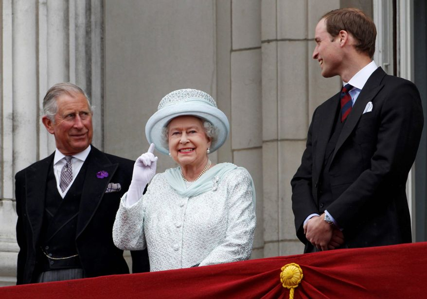 Britain's Prince Charles, Britain's Queen Elizabeth II and Prince William stand on the balcony at Buckingham Palace during the Diamond Jubilee celebrations in central London.  (AP Photo/Stefan Wermuth, Pool)