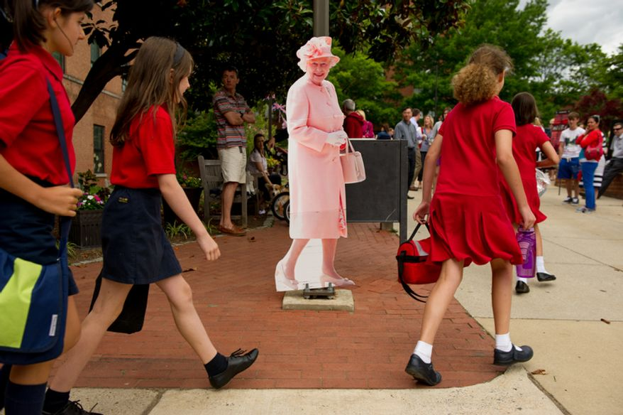 """Students at the the British School of Washington walk past a life sized cut out of Queen Elizabeth II as the school, along with the British Embassy, host a """"Big Picnic Lunch"""" in celebration of Queen Elizabeth's Diamond Jubilee, Washington, D.C., Tuesday, June 5, 2012. The Diamond Jubilee of Queen Elizabeth II is a celebration of 60 years that the queen has been ruling. (Andrew Harnik/The Washington Times)"""