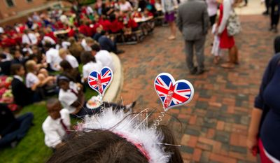"""Karen Pena, a history teacher with the The British School of Washington, wears hearts made out of the British flag on her head during the school's """"Big Picnic Lunch"""" in celebration of Queen Elizabeth's Diamond Jubilee, Washington, D.C., Tuesday, June 5, 2012.  (Andrew Harnik/The Washington Times)"""