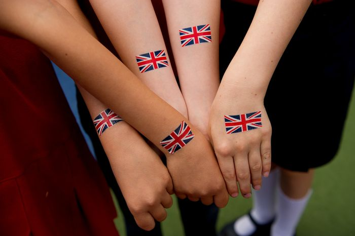 "Students with the British School of Washington get British flag fake tattoos during the school's ""Big Picnic Lunch"" in celebration of Queen Elizabeth's Diamond Jubilee, Washington, D.C., Tuesday, June 5, 2012. The Diamond Jubilee of Queen Elizabeth II is a celebration of 60 years that the queen has been ruling. (Andrew Harnik/The Washington Times)"
