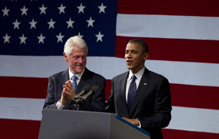 Former President Bill Clinton claps as President Obama arrives to speak at a campaign event at the New Amsterdam Theatre in New York on June 4, 2012. (Associated Press)