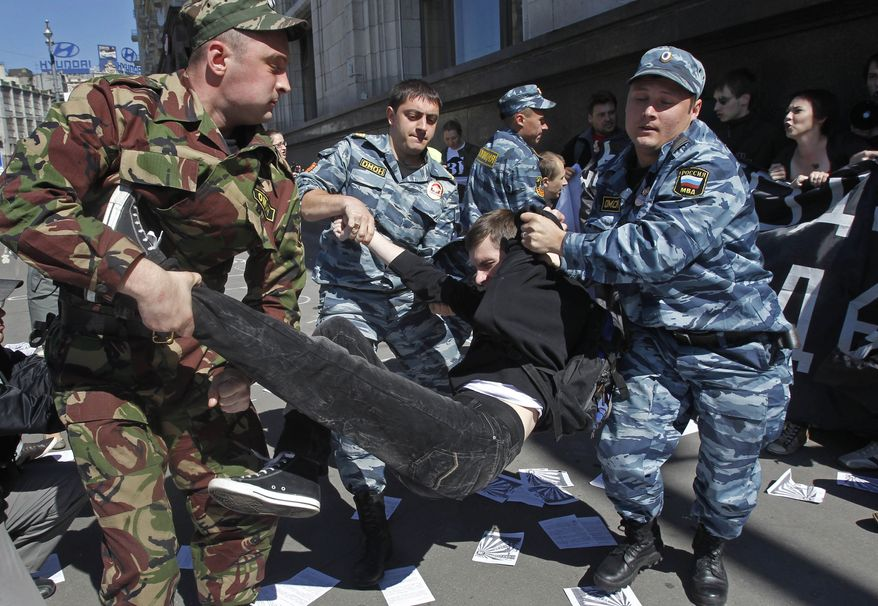 Russian police detain protesters outside the parliament building in Moscow on Tuesday, June 5, 2012, during a demonstration against a proposed law that would increase fines for participating in unsanctioned rallies. (AP Photo/Misha Japaridze)
