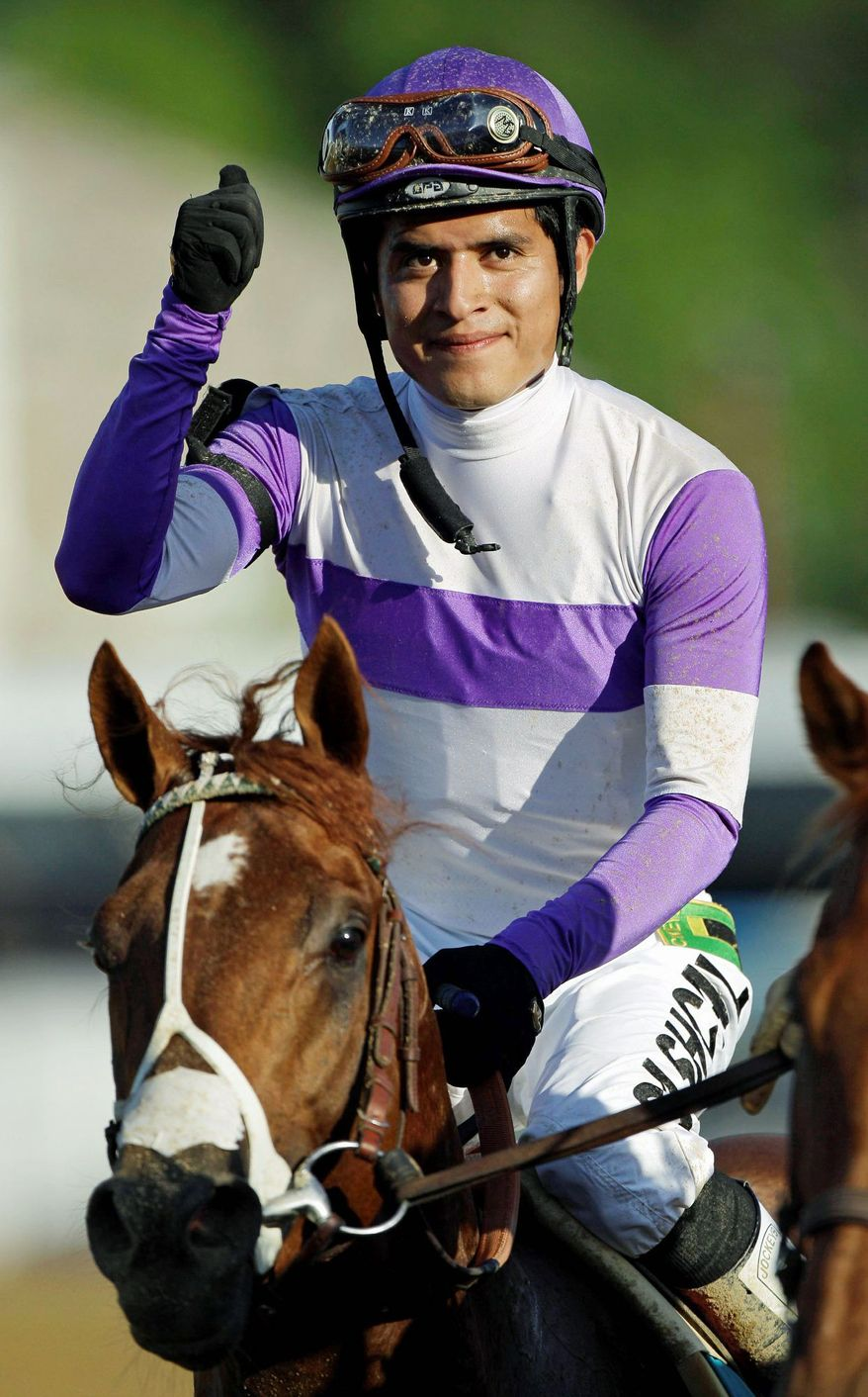 Jockey Mario Gutierrez, 25, hasn't looked back since owner Paul Reddam and trainer Doug O'Neill put him on I'll Have Another before the Robert B. Lewis Stakes at Santa Anita in February. Victories in the Kentucky Derby and Preakness Stakes followed, and now Gutierrez is on the brink of Triple Crown history. (Associated Press)