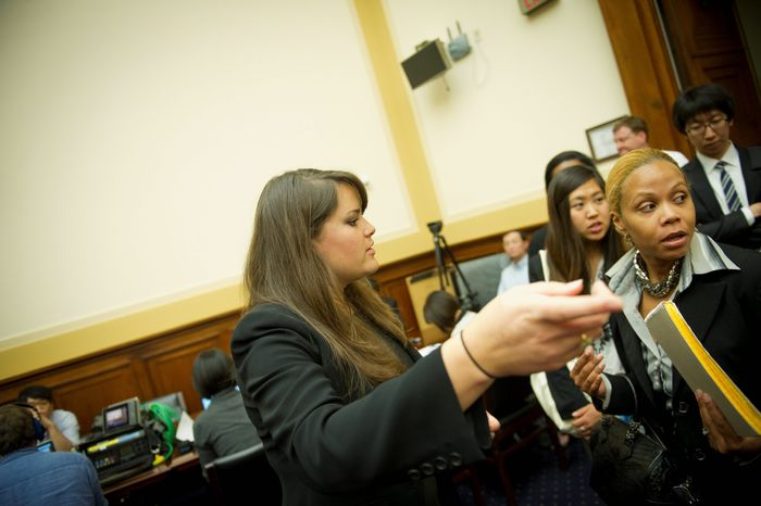 Jessica Santana, a staffer since February for Rep. Donald A. Manzullo, Illinois Republican, helps seat people arriving for a House subcommittee hearing Wednesday. Ms. Santana will need a new employer next year, as Mr. Manzullo will be leaving Congress in January. (Rod Lamkey Jr./The Washington Times)