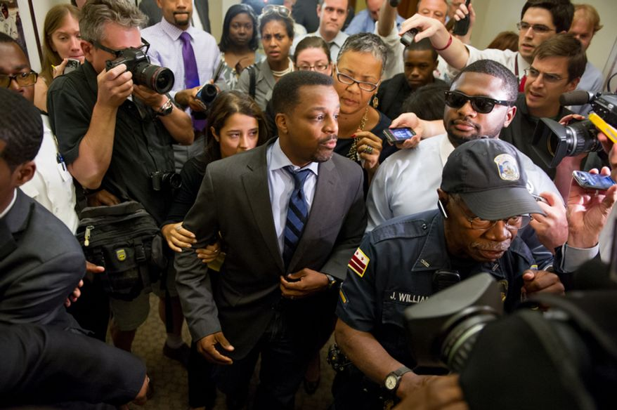 D.C. Council Chairman Kwame Brown leaves his office at the Wilson Building after being charged with one felony count of bank fraud and later resigned from the council, Washington, D.C., Wednesday, June 6, 2012. (Andrew Harnik/The Washington Times)