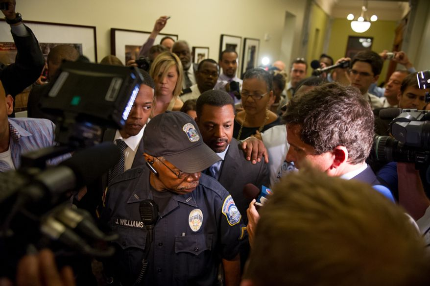 D.C. Council Chairman Kwame Brown leaves his office at the Wilson Building after being charged with one felony count of bank fraud and later resigned. (Andrew Harnik/The Washington Times)