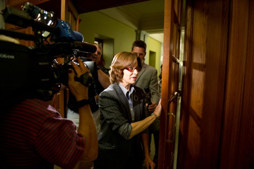 D.C Councilmember and chairman pro tempore Mary Cheh (D-Ward 3), goes into D.C. Council Chairman Kwame Brown's offices as he is charged with one felony count of bank fraud, Washington, D.C., Wednesday, June 6, 2012.  (Andrew Harnik/The Washington Times)