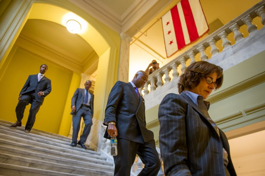 D.C Counci member and chairman pro tempore Mary Cheh (D-Ward 3), right, council members Michael A. Brown (D-At Large), second from right, and newly elected Kenyan McDuffie (D-Ward 5), left, leave a private meeting at the Wilson Building as Council Chairman Kwame R. Brown (D) is charged with one felony count of bank fraud and is expected to resign his from the council, Washington, D.C., Wednesday, June 6, 2012. (Andrew Harnik/The Washington Times)