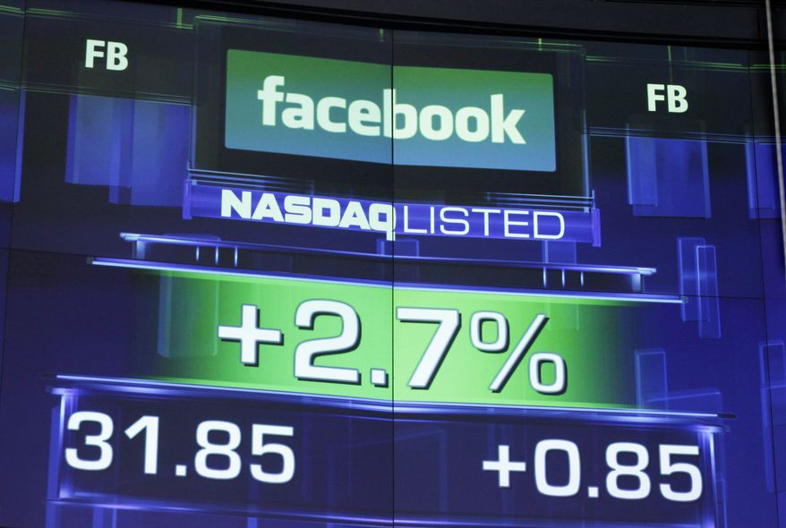 **FILE** The pre-market price for Facebook is seen May 23, 2012, at the Nasdaq MarketSite in New York. (Associated Press)
