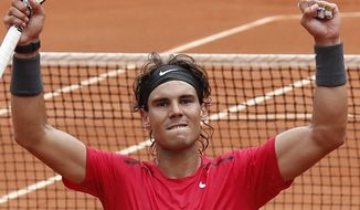 Rafael Nadal celebrates winning his quarter final match against Nicolas Almagro at the French Open atRoland Garros stadium in Paris on Wednesday June 6, 2012. Nadal won in three sets: 7-6, 6-2, 6-3. (AP Photo/Bernat Armangue)