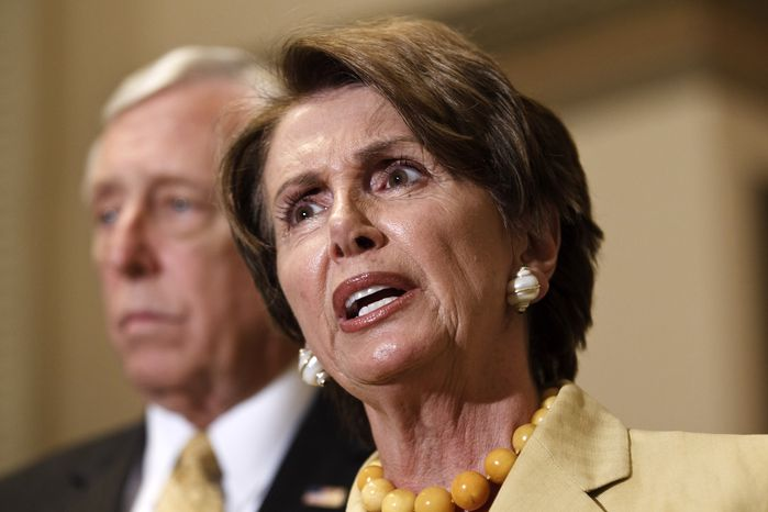House Minority Leader Nancy Pelosi, California Democrat, speaks June 1, 2012, during a news conference on Capitol Hill. In the background is House Minority Whip Steny Hoyer, Maryland Democrat. (Associated Press)