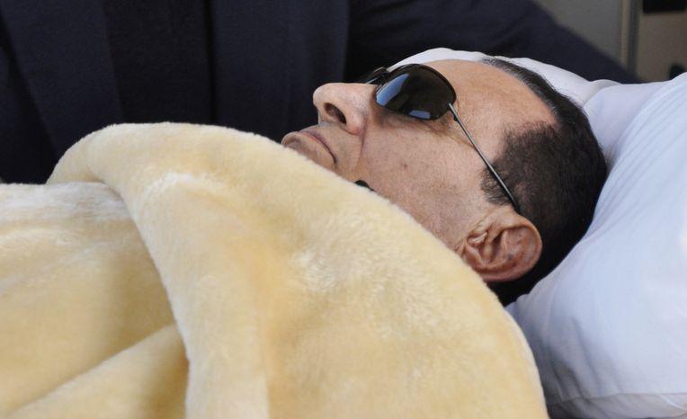 **FILE** Former Egyptian President Hosni Mubarak is wheeled into court in Cairo on Jan. 29, 2012. (Associated Press)