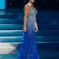 In this photo provided by the Miss Universe Organization, Miss Pennsylvania Sheena Monnin competes during the 2012 Miss USA Presentation Show on Wednesday, May 30, 2012 in Las Vegas. Monnin resigned her crown claiming the contest is rigged, but according to organizers the beauty queen was upset over the decision to allow transgender contestants to enter. (AP Photo/Miss Universe Organization, Darren Decker)