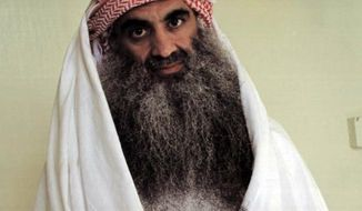 **FILE** This undated photo downloaded from the Arabic language Internet site www.muslm.net purports to show Khalid Sheik Mohammed, the accused mastermind of the Sept. 11 attacks, in detention at Guantanamo Bay, Cuba. (Associated Press/muslm.net)