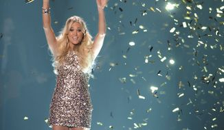 Carrie Underwood performs Wednesday in Nashville, Tenn., at the 2012 CMT Music Awards, where she won video of the year for the third time and also collaboration of the year. (Associated Press)