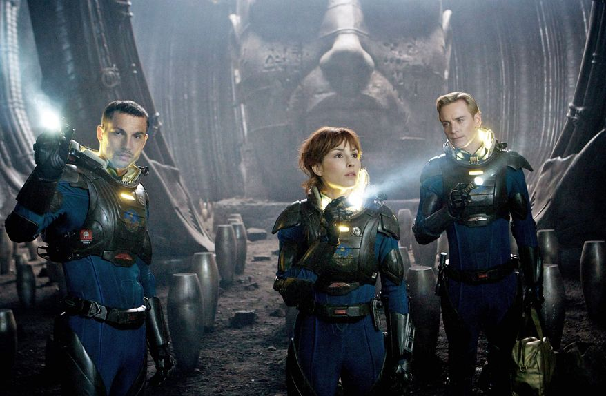 """Logan Marshall-Green (left) and Noomi Rapace are scientists tracking humanity's origins, a search that takes them to another galaxy, and Michael Fassbender (right) is an android in """"Prometheus."""" (20th Century Fox via Associated Press)"""