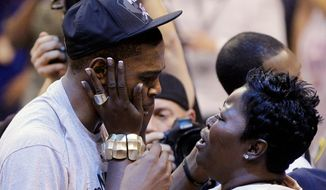 Oklahoma City forward Kevin Durant was greeted by his mother, Wanda Pratt, after the Thunder clinched the Western Conference on Wednesday. (Associated Press)