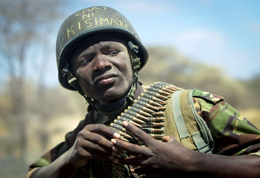 """The helmet of Kenyan soldier Nicholas Munyanya reads in Kiswahili """"Tea in Kismayo,"""" no doubt hoping for respite in the strategic Somali port city that African Union troops hope to wrest from the control of al-Shabab terrorists by late August. (Associated Press)"""