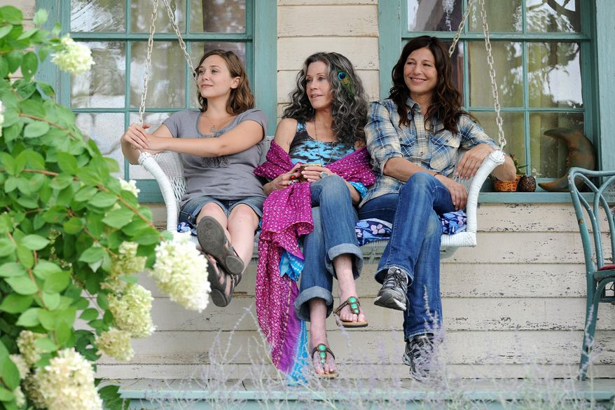 "Elizabeth Olsen, Jane Fonda and Catherine Keener appear in a scene from ""Peace Love and Misunderstanding."" Ms. Fonda plays Grace, a half-baked peacenik and the mother of Diane (Ms. Keener), a Manhattan lawyer and uptight conservative going through a divorce. Zoe (Ms. Olsen) grows on viewers. (Associated Press)"