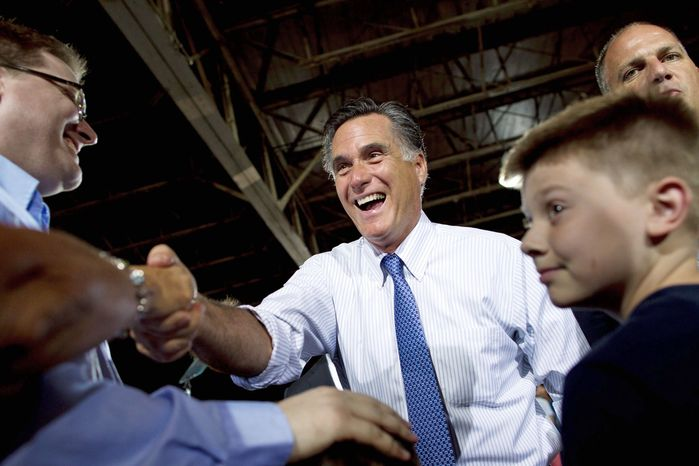 ** FILE ** Presumptive Republican presidential nominee Mitt Romney campaigns in St. Louis. Now that the primaries are effectively over, Mr. Romney has turned his attention to fundraising. (Associated Press)