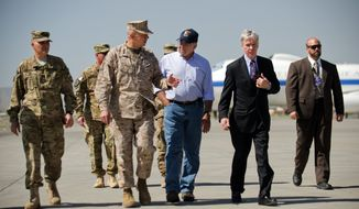 U.S. Defense Secretary Leon Panetta, center right, speaks with U.S. Ambassador to Afghanistan Ryan Crocker, second right, and the head of NATO coalition forces in Afghanistan Gen. John Allen, center left, upon his arrival at Kabul International Airport in Kabul, Afghanistan Thursday, June 7, 2012. (AP Photo/Jim Watson, Pool)