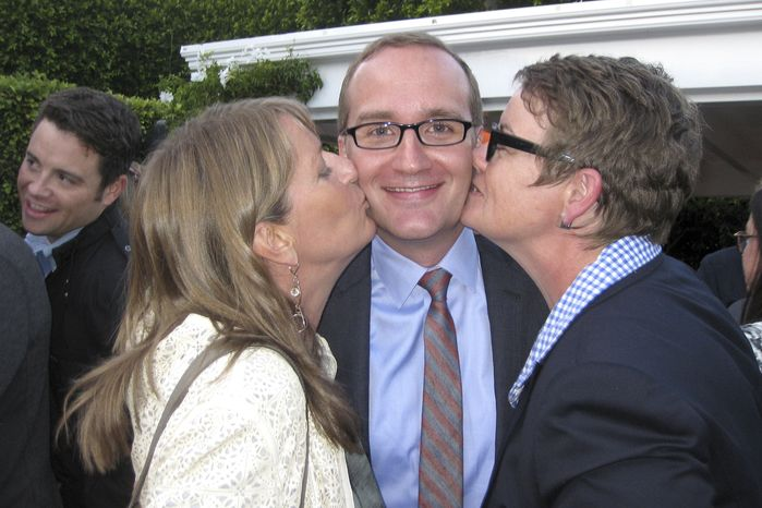 In this Monday, June 4, 2012, photo provided by Karen Ocamb from LGBT POV, Chad Griffin, center, is kissed by Sandy Stier, left, and Kris Perry at the home of actor/director Rob Reiner, who co-founded the American Foundation for Equal Rights, in Brentwood, Calif. (AP Photo/LGBT POV, Karen Ocamb)