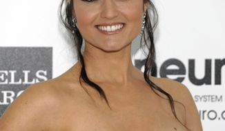 """** FILE ** In this photo from Sun., Feb. 26, 2012, actress Danica McKellar arrives at the Elton John AIDS Foundation Academy Awards viewing party in West Hollywood, Calif. McKellar, who starred in the ABC series """"The Wonder Years,"""" filed to end her three-year marriage to composer Michael Verta on Monday, June 4, 2012, in Los Angeles. (Associated Press)"""