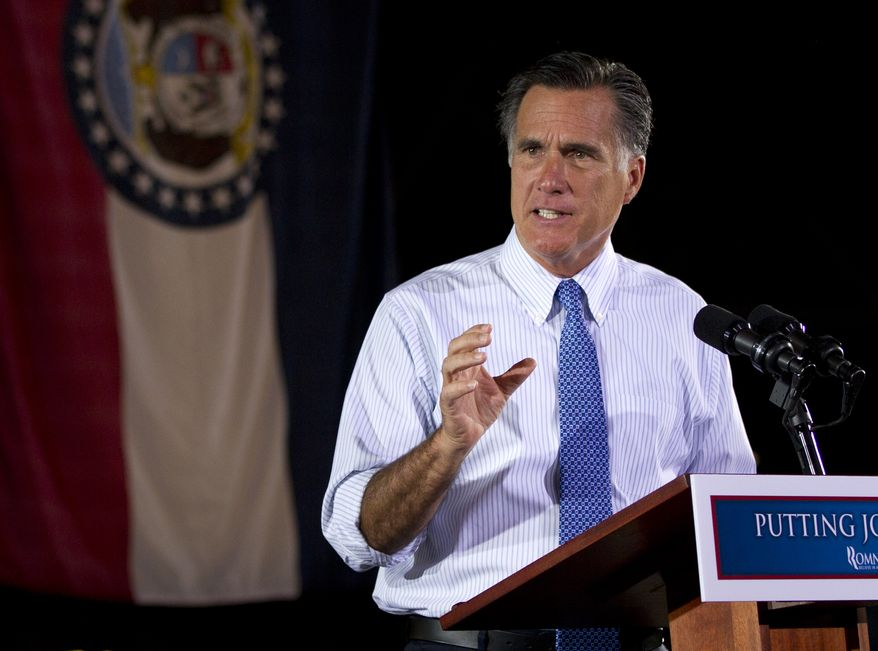 Republican presidential candidate and former Massachusetts Gov. Mitt Romney gestures June 7, 2012, during a campaign stop at Production Products in St. Louis, Mo. (Associated Press)