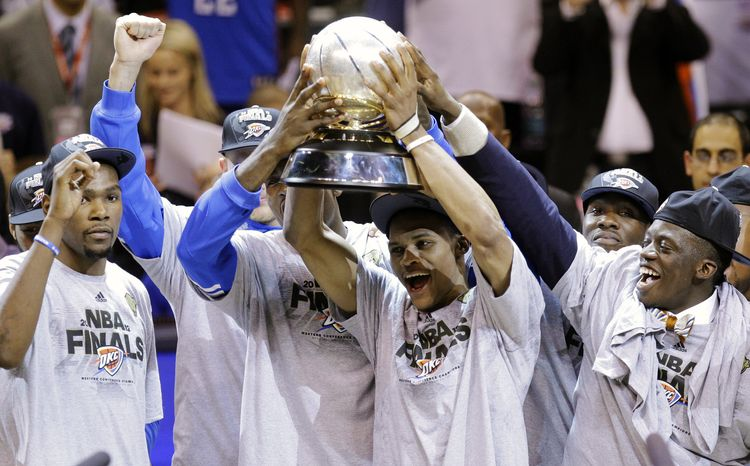 The Oklahoma City Thunder celebrate winning the Western Conference after defeating the San Antonio Spurs in Game 6 on Wednesday night 107-99 to advance to the NBA finals. (AP Photo/Sue Ogrocki)