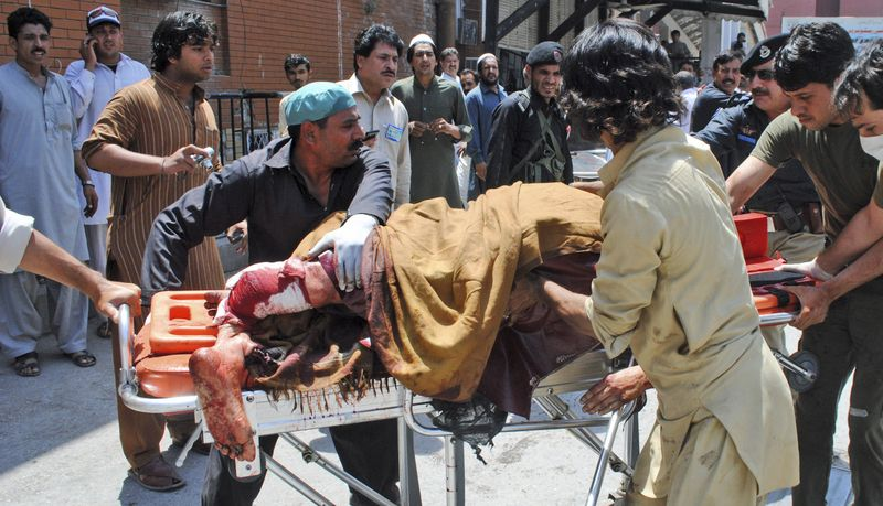 A Pakistani man injured in a bomb blast is wheeled  June 8, 2012 on a stretcher to a hospital in Peshawar, Pakistan. The bomb tore through a bus carrying government employees and other civilians in northwestern Pakistan, killing several people in an attack that served as a reminder of the continued militant threat despite a significant drop in violence over the past year, officials said. (Associated Press)