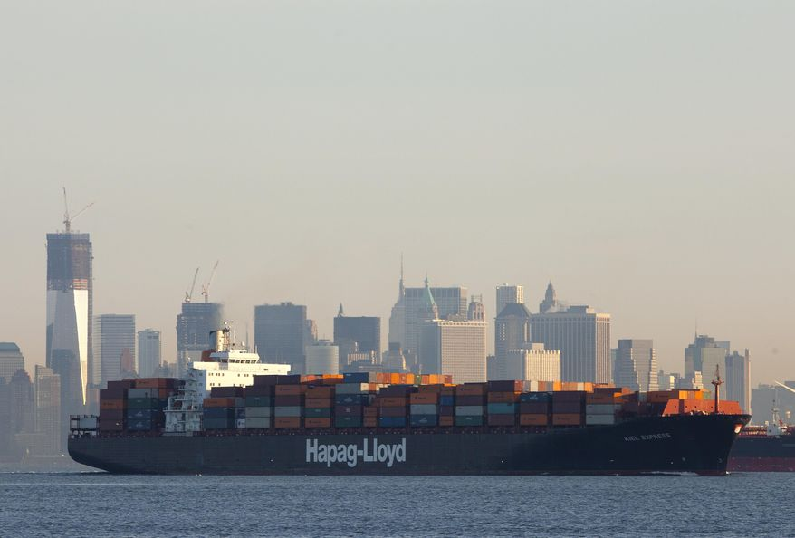 **FILE** A cargo ship owned by German shipping company Hapag-Lloyd crosses New York Harbor on Feb. 4, 2012. (Associated Press)