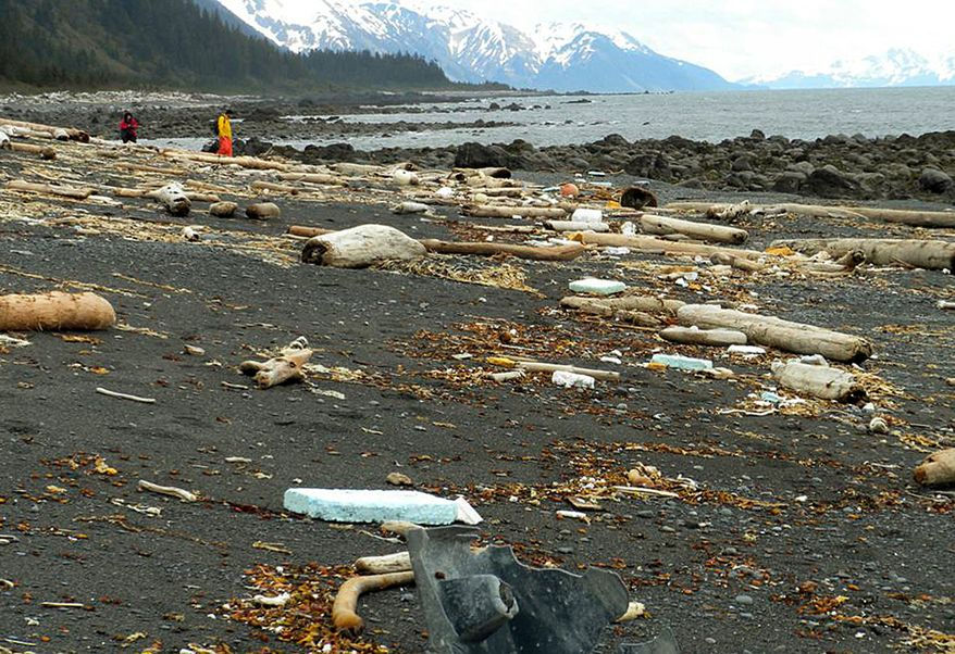 Debris is strewn June 6, 2012, across the shore of Montague Island near Seward, Alaska. More than a year after a tsunami devastated Japan, killing thousands of people and washing millions of tons of debris into the Pacific Ocean, neither the U.S. government nor some West Coast states have a clear plan for how to clean up the rubble that floats to American shores. (Associated Press/Chris Pallister)