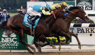 Union Rags with jockey John Velazquez up, right, charges past Paynter with jockey Mike Smith to win the 144th Belmont Stakes at Belmont Park in Elmont, N.Y., on Saturday, June 9, 2012. (AP Photo/Mike Groll)