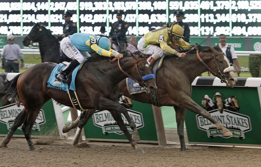 Jockey John Velazquez, right, drives Union Rags past front-running Paynter and jockey Mike Smith, left, as they approach the finish line of the Belmont Stakes horse race at Belmont Park in Elmont, N.Y., Saturday, June 9, 2012. (AP Photo/Garry Jones)