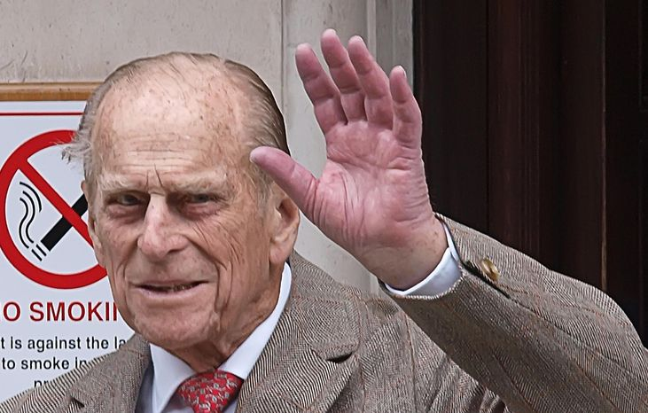 Prince Philip waves as he leaves King Edward VII Hospital in central London on Saturday, June 9, 2012, after being treated for a bladder infection. He will celebrate his 91st birthday Sunday privately with members of the royal family. (AP Photo/Press Associaiton, Max Nash)