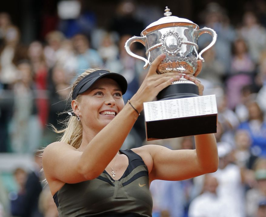 Maria Sharapova holds the trophy after winning the women's final match against Sara Errani at the French Open in Roland Garros stadium in Paris, Saturday June 9, 2012. Sharapova won in two sets 6-3, 6-2. (AP Photo/Michel Euler)