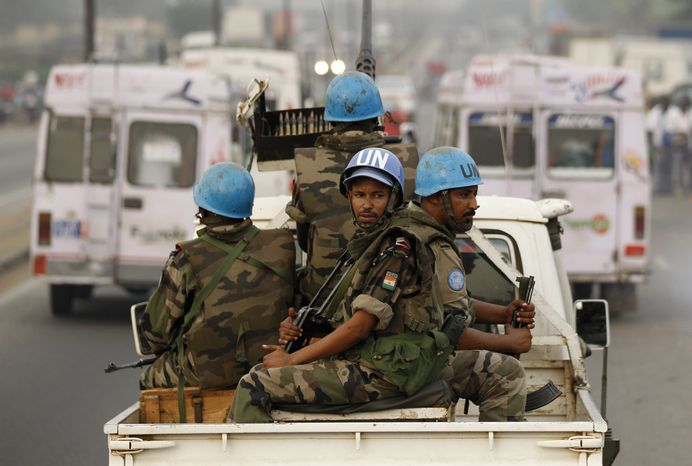 ** FILE ** U.N. soldiers from Niger conduct a patrol through the streets of Abidjan, Ivory Coast, on Jan. 10, 2011. (AP Photo/Rebecca Blackwell)