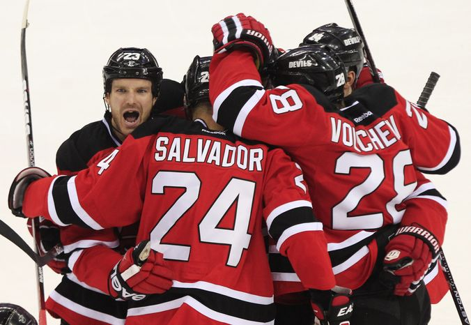 Bryce Salvador celebrates what ended up being the game-winning goal for the New Jersey Devils in Game 5 of the Stanley Cup Final against the Los Angeles Kings. The Devils forced a Game 6 with a 2-1 win Saturday. (AP Photo/Frank Franklin II)