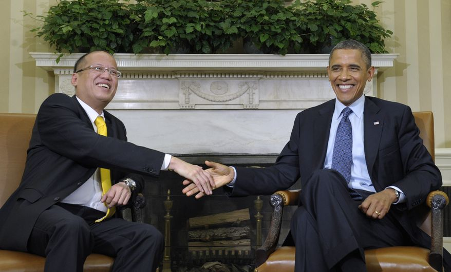 President Obama meets with Philippines President Benigno Aquino III (left) on Friday, June 8, 2012, in the Oval Office of the White House in Washington. (AP Photo/Susan Walsh)
