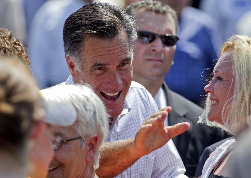 Republican presidential candidate Mitt Romney greets supporters following a campaign stop in Council Bluffs, Iowa, on Friday, June 8, 2012. (AP Photo/Nati Harnik)