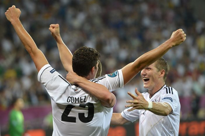 Germany's Mario Gomez and Bastian Schweinsteiger celebrate Gomez's goal during the Euro 2012 Group B match between against Portugal in Lviv, Ukraine, Saturday, June 9, 2012. Germany won 1-0. (AP Photo/Martin Meissner)