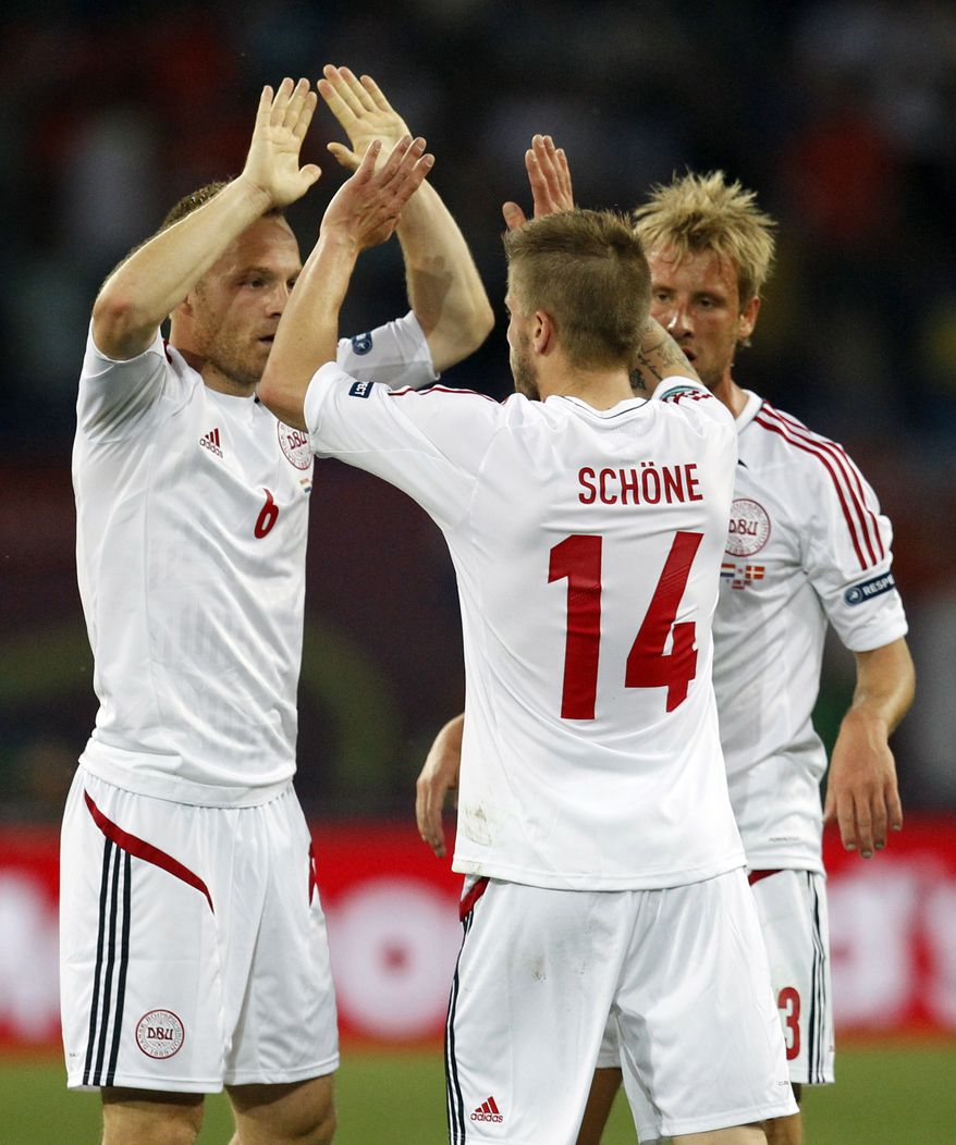 From the left, Denmark's Lars Jacobsen, Lasse Schone and Tobias Mikkelsen celebrate their victory at the Euro 2012 Group B match between the Netherlands and Denmark in Kharkiv, Ukraine, on Saturday, June 9, 2012. Denmark won the match 1-0. (AP Photo/Matthias Schrader)