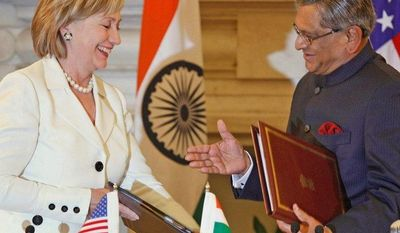 ** FILE ** Secretary of State Hillary Rodham Clinton and her Indian counterpart, External Affairs Minister S.M. Krishna, meet in New Delhi in 2009. (Associated Press)
