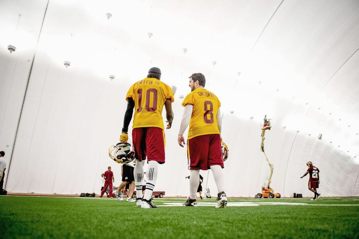 Redskins quarterback Rex Grossman (8) knows he is the backup to rookie Robert Griffin III (10) but prepares as if the call will come for him to return to the lineup. He also serves as a mentor to rookie Kirk Cousins and second-year pro Jonathan Crompton. (Andrew Harnik/The Washington Times)