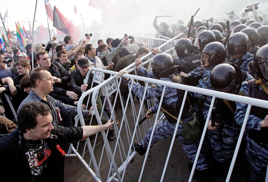 Russian riot police try to disperse opposition protesters in downtown Moscow on the eve of Vladimir Putin's inauguration in May. Mr. Putin has taken a harder line against the opposition since returning to the presidency, threatening demonstrators with prison time and onerous fines. (Associated Press)